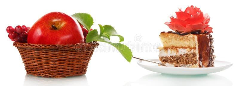 点心蛋糕和红色苹果 免版税图库摄影