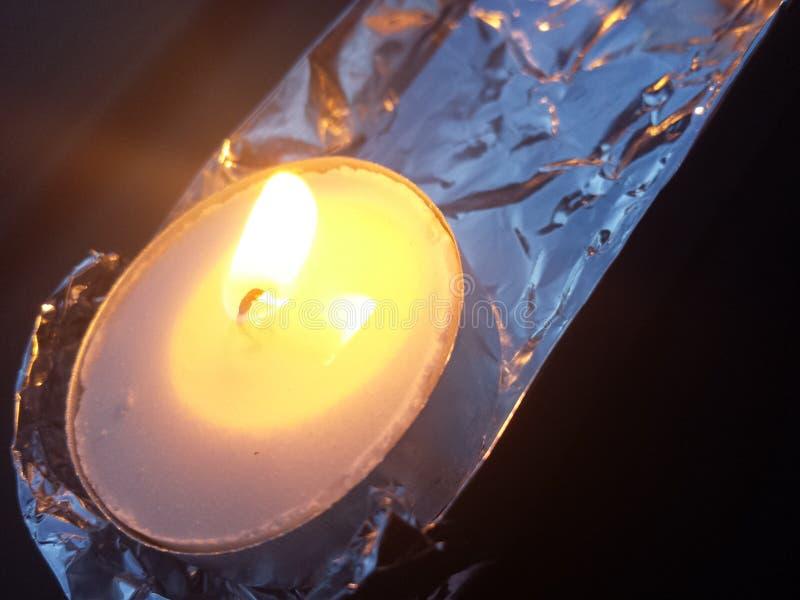 点蜡烛的箔 免版税库存图片