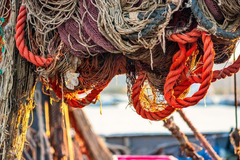烘干在拖网渔船的捕鱼网 免版税库存照片