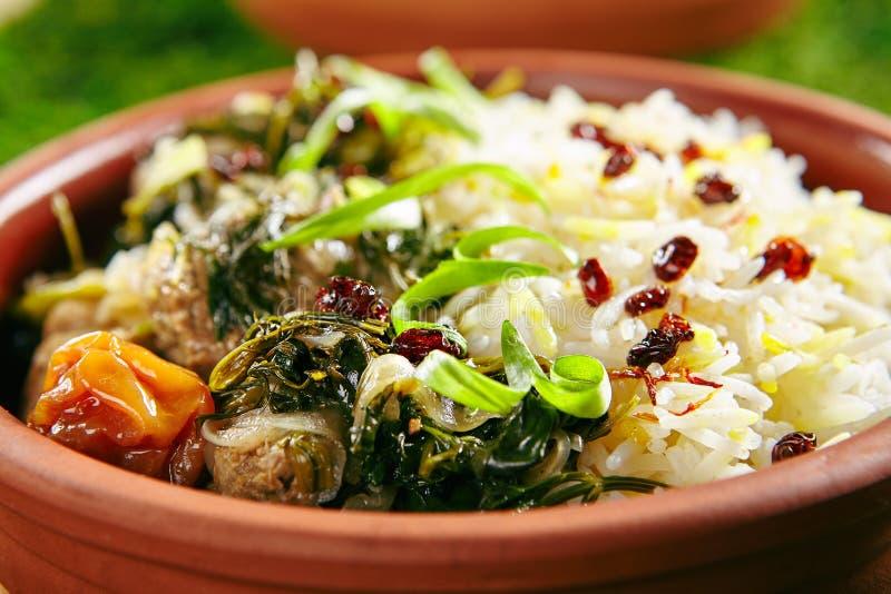 烘烤肉用米和草本 免版税库存照片