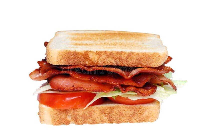 烟肉俱乐部查出的莴苣三明治蕃茄 免版税图库摄影