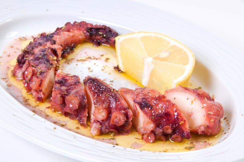 烤章鱼用柠檬调味汁。 库存图片