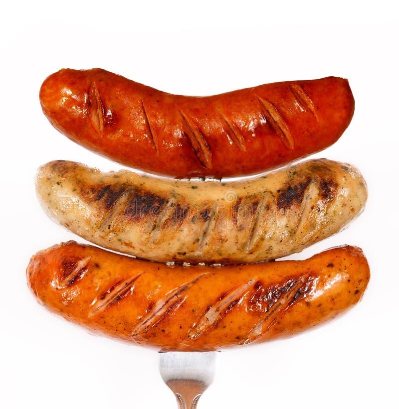 烤肉不健康烤的香肠 免版税库存图片