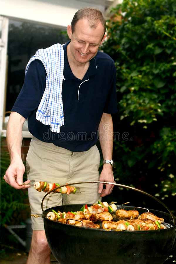 烤肉人趋向于 库存图片