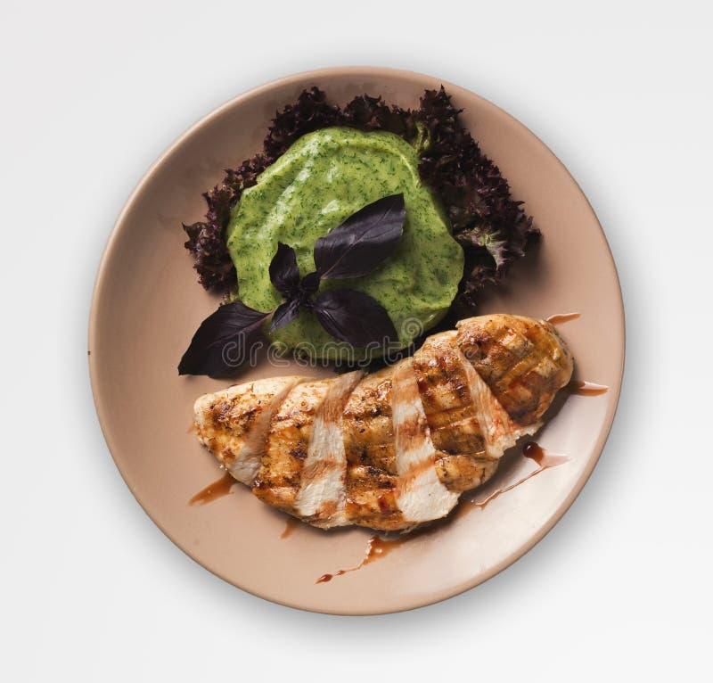 烤鸡内圆角用菠菜土豆纯汁浓汤,被隔绝 图库摄影