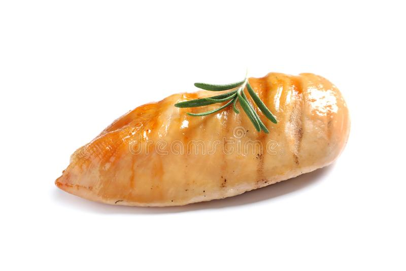 烤鸡胸脯用在白色隔绝的迷迭香 免版税图库摄影