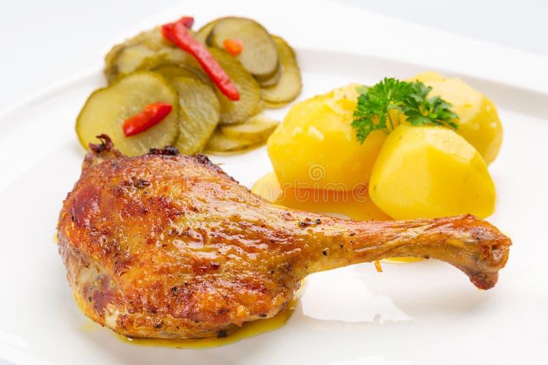 烤鸭行程用土豆 免版税库存图片