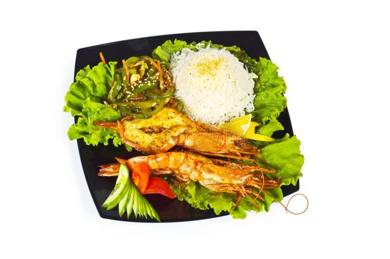 烤龙虾、米和蔬菜 库存图片