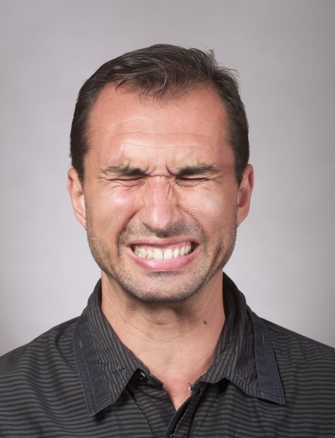 烦乱man's面孔 免版税库存图片