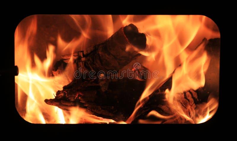 烧在壁炉的火的木头 库存照片
