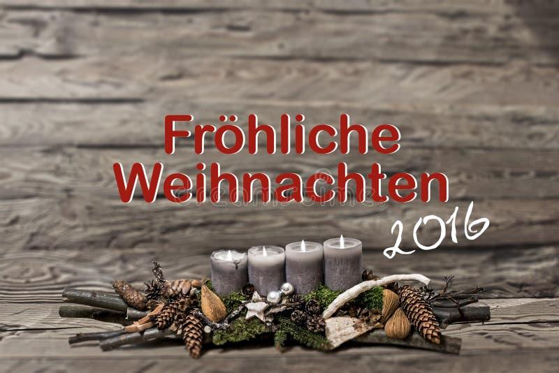 烧灰色蜡烛正文消息德语的圣诞快乐装饰2016年 图库摄影