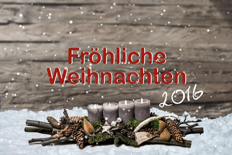 烧灰色蜡烛雪正文消息德语的圣诞快乐装饰2016年 免版税库存图片