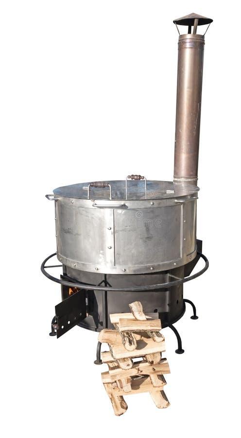 热一个新的生铁木的火炉烧 库存照片