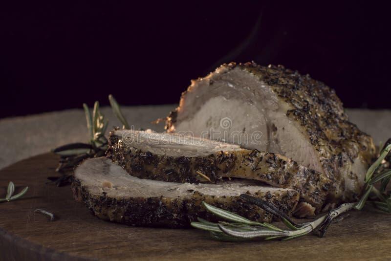 热烤火腿和迷迭香 库存图片