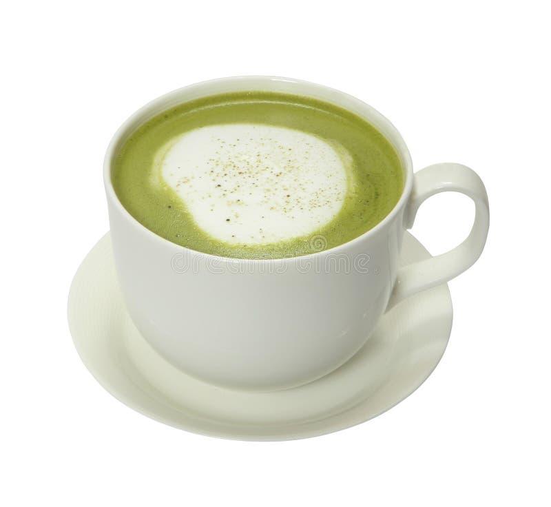 热的绿茶用蒸的牛奶,通常冠上用发泡的牛奶 库存照片