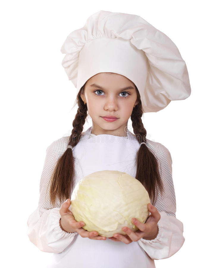 烹调和人概念-厨师帽子的微笑的小女孩 库存照片