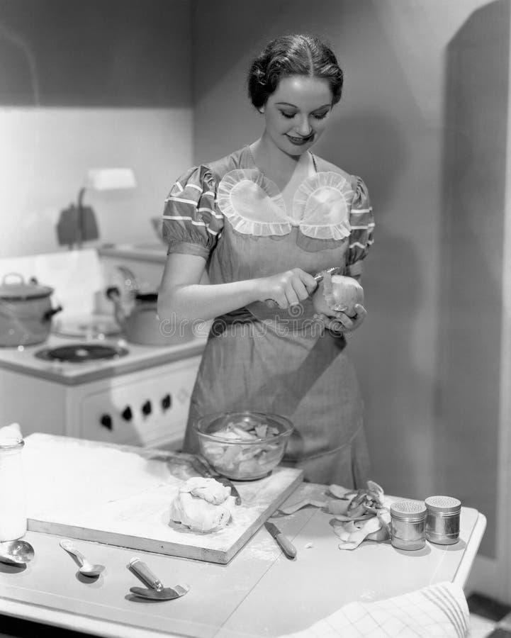 烹调在厨房里的妇女画象(所有人被描述不更长生存,并且庄园不存在 供应商保单t 免版税库存照片