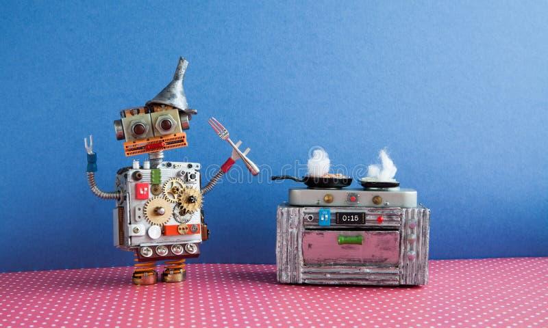 烹调煎锅,电子火炉烤箱的机器人厨师 创造性的设计戏弄,自动化机器人未来聪明的家庭概念 库存图片