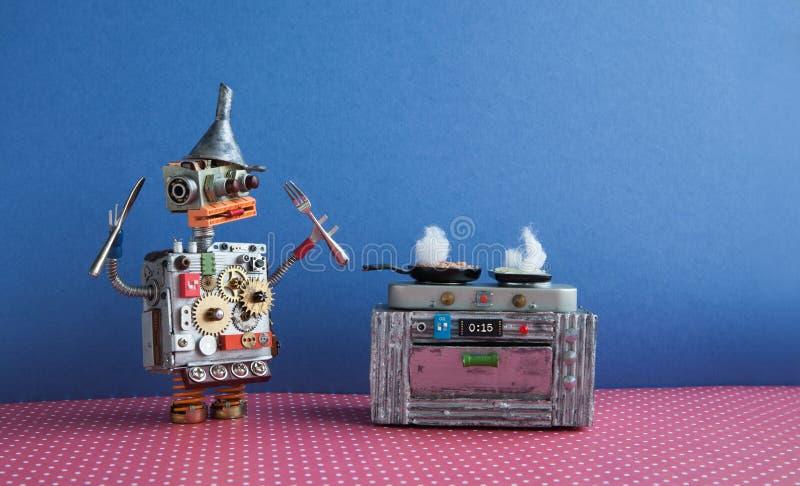 烹调煎锅,电子火炉烤箱的机器人厨师 创造性的设计戏弄,自动化机器人未来聪明的家庭概念 免版税图库摄影