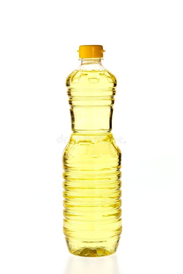 烹调的菜油在白色隔绝的瓶 免版税图库摄影