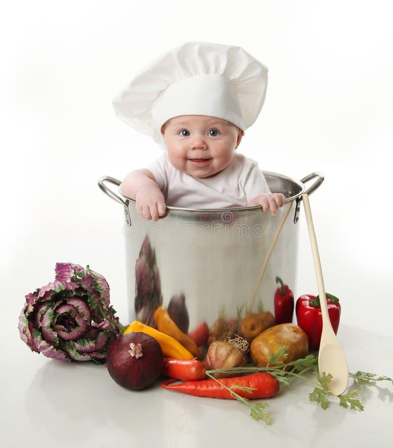 烹调罐的婴孩 库存照片