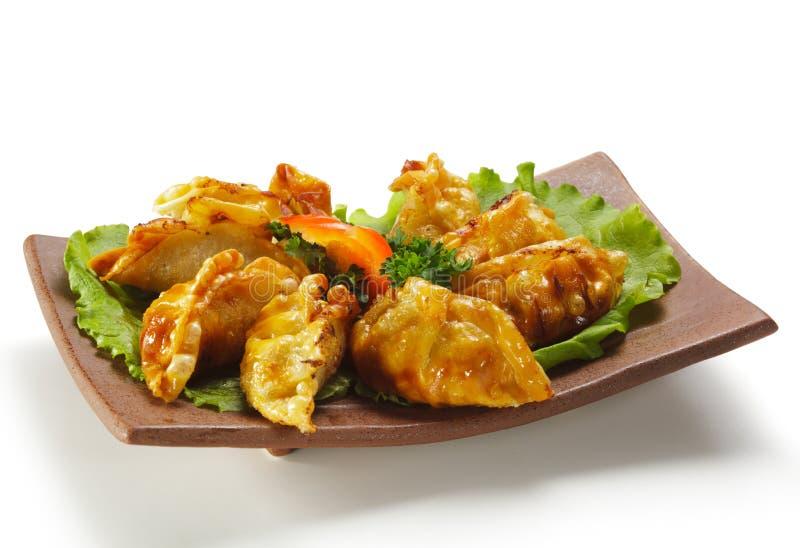 烹调饺子日本人肉 免版税库存照片