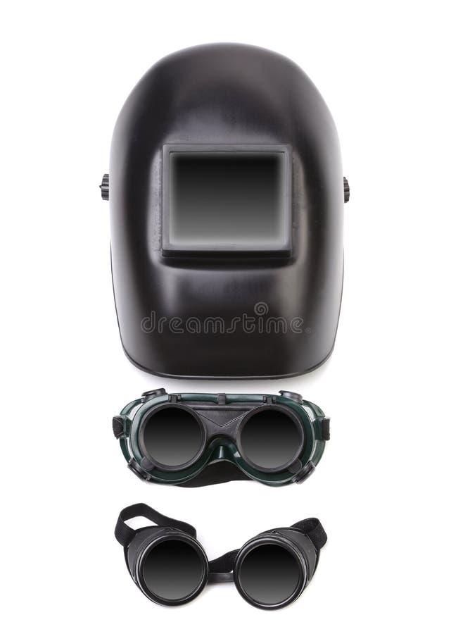 焊接面具和两块玻璃。 图库摄影