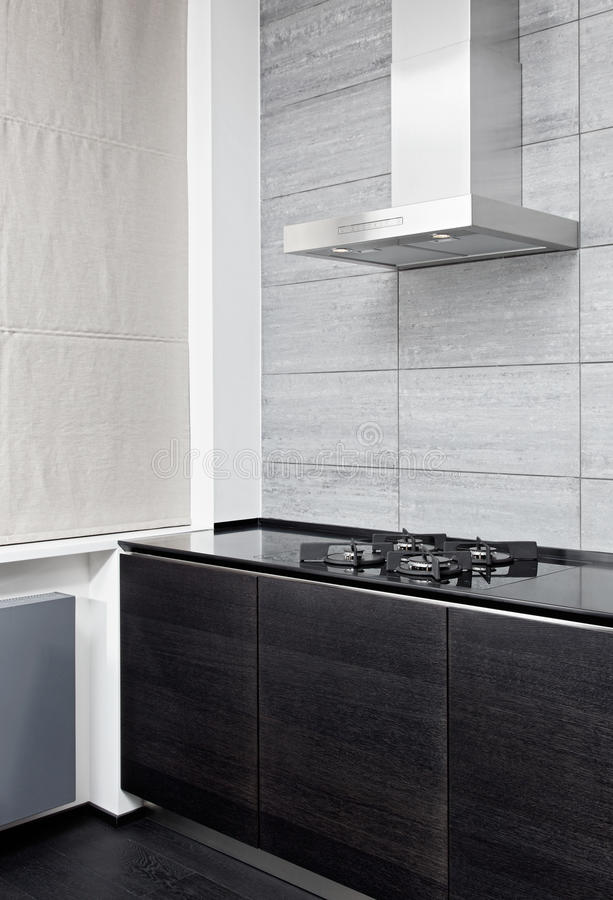 煤气炉和在现代厨房的烹调敞篷 免版税库存照片