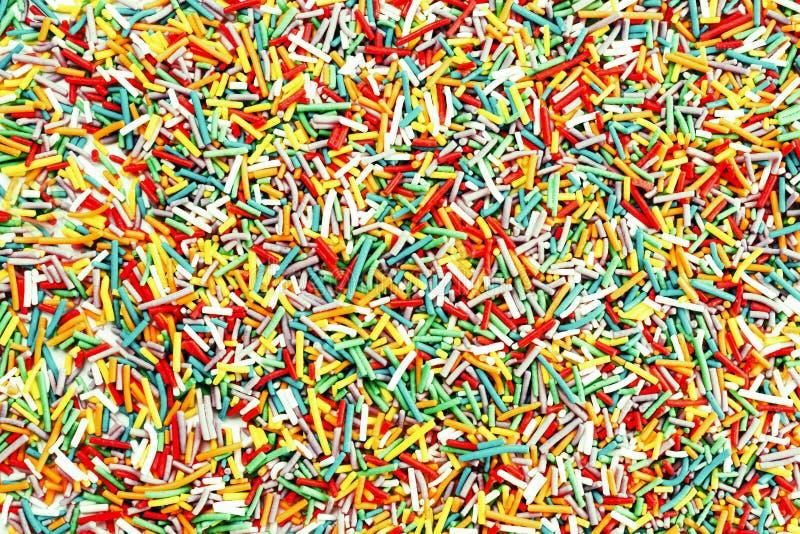 照片五颜六色的氖洒糖果为背景使用,顶面v 免版税库存图片