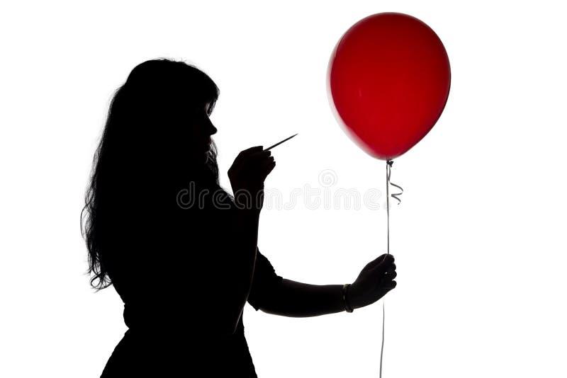 照片刺穿了有针气球的妇女 免版税图库摄影