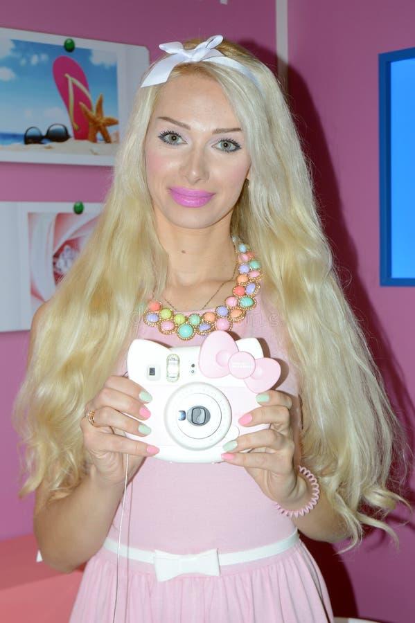 照片商展2015 莫斯科女孩式样摆在 免版税库存图片