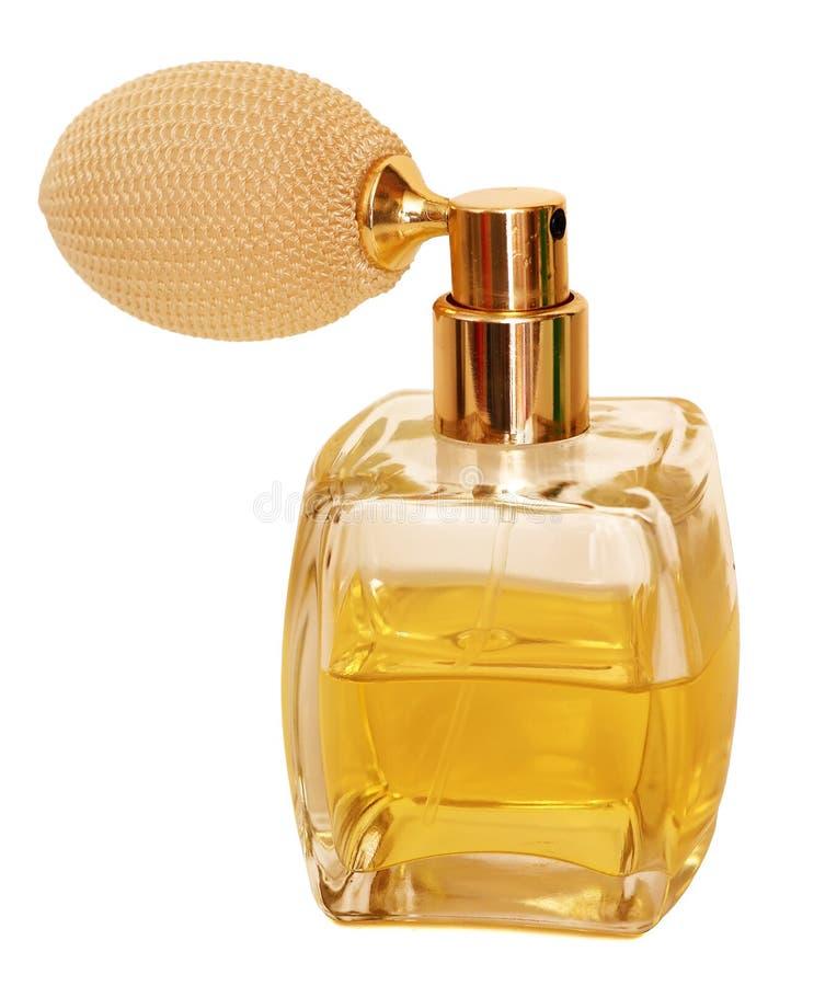 照片在冠形状的香水喷子瓶,隔绝在白色背景 免版税库存照片