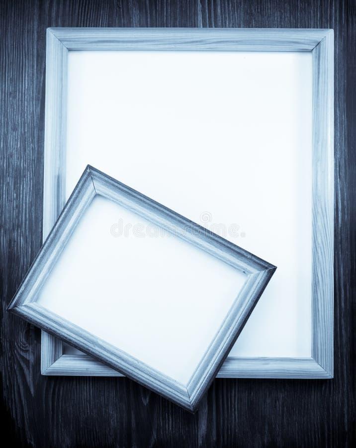 照片在木头的画框 库存图片