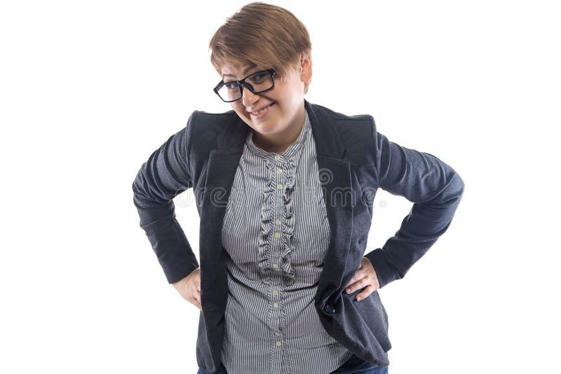 照片微笑的妇女用在臀部的手 图库摄影