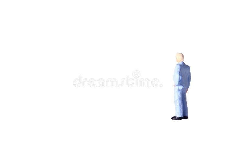 照片摆在微型图被隔绝的玩具灰色头发商人在白色为compositing的使用 向量例证