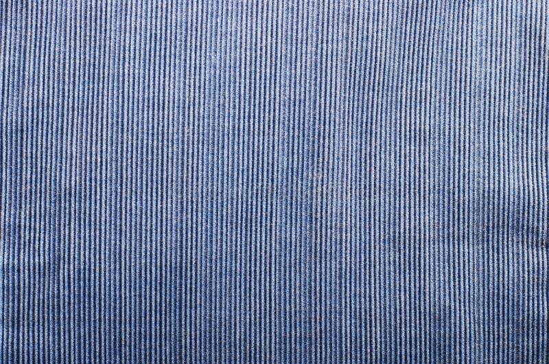 照片背景的蓝色条绒织品纹理关闭 免版税图库摄影