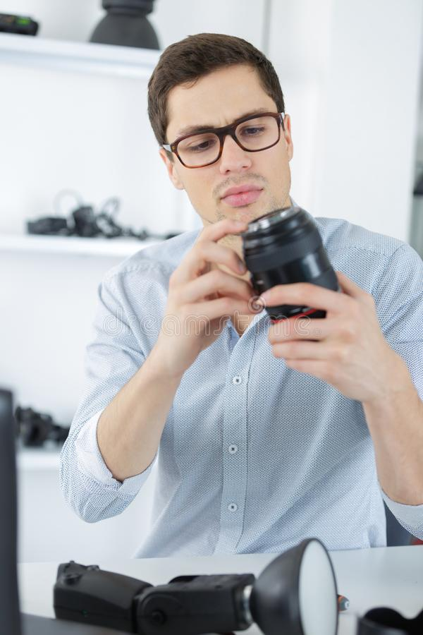 照片镜头修理维护支持 免版税库存图片