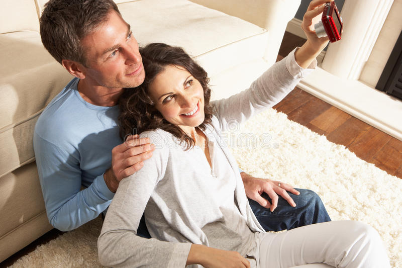 照相机夫妇数字式家庭照片采取 免版税库存图片