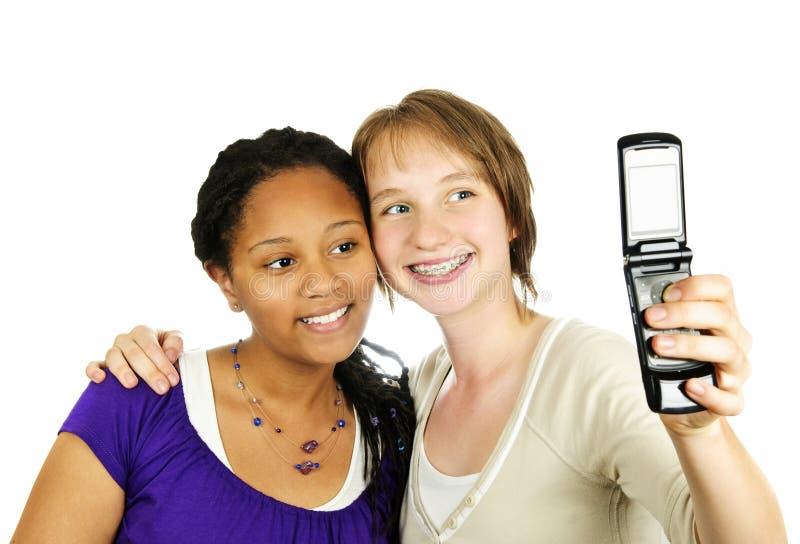 照相机女孩给青少年打电话 免版税库存照片