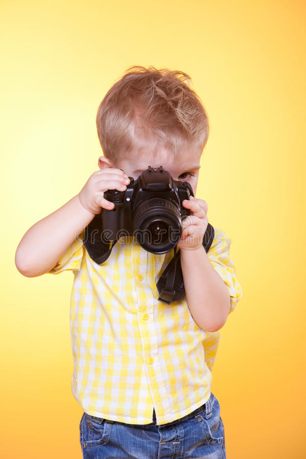 照相机小摄影师专业射击 免版税图库摄影