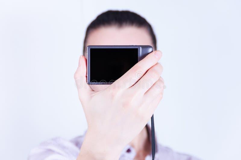 照相机表面拍摄了妇女 库存图片