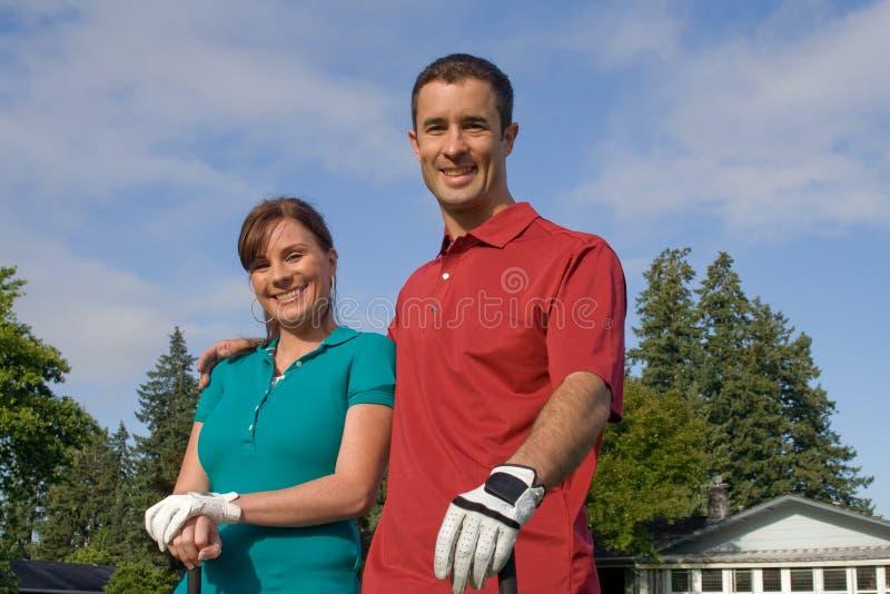 照相机高尔夫球运动员水平的微笑 免版税库存图片