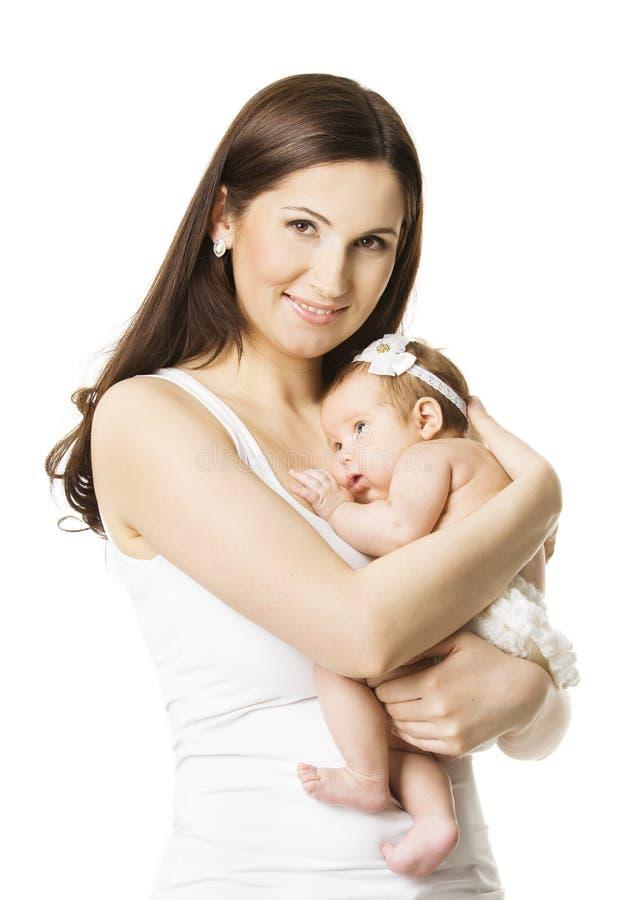 照顾女婴画象,拿着新出生的小孩的妇女 免版税库存图片