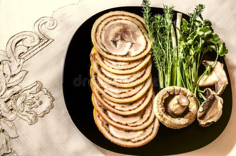 熏制的猪里脊肉圆的切片肉饼  库存图片