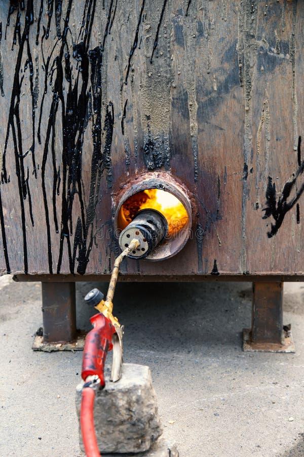 熔化的沥青的,联接与溶解的双的沥青的设定锅炉 免版税图库摄影