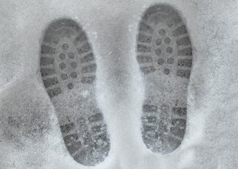 熔化的shoeprints雪 免版税库存图片