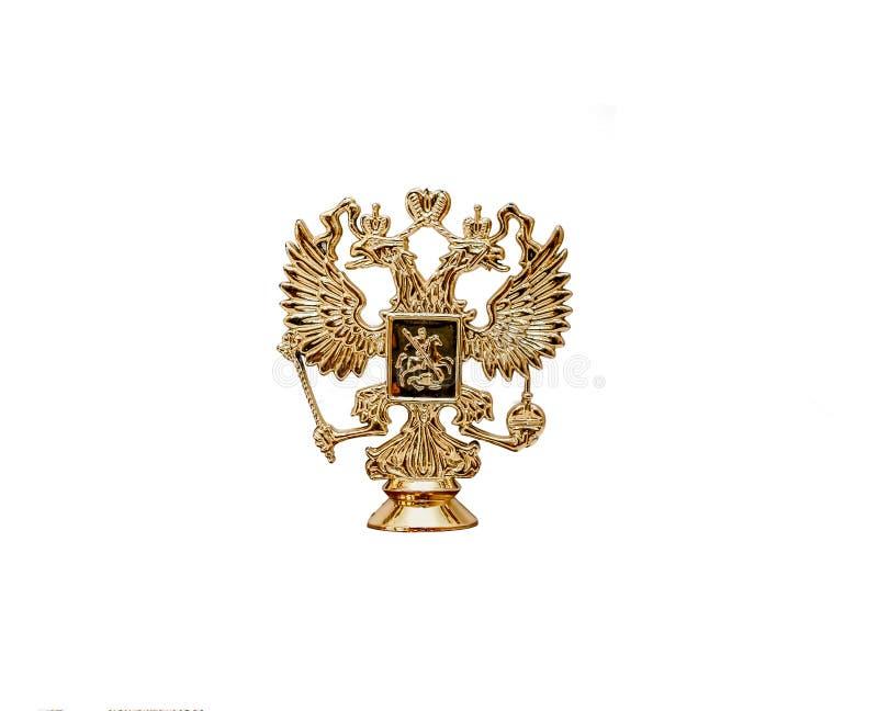 熔铸在白色背景隔绝古铜色俄国徽章 俄国状态象征-一只双重朝向的老鹰 免版税库存图片