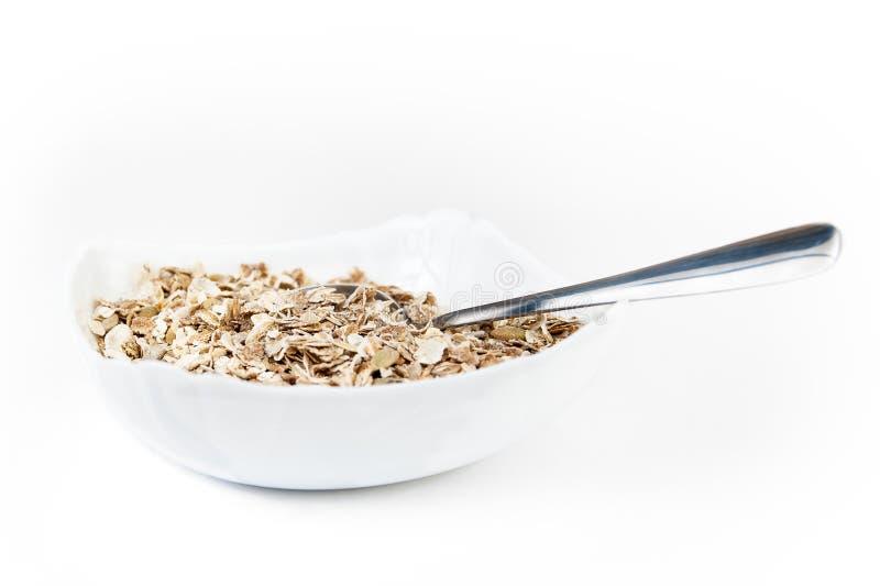 燕麦剥落与在碗的种子 库存照片