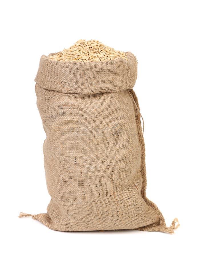 燕麦在粗麻布大袋袋子的结晶母粒 免版税库存图片