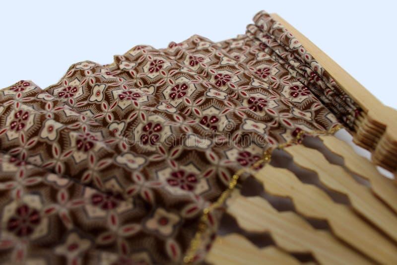 爪哇布料的一个木手爱好者叫蜡染布 免版税图库摄影